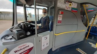 Photo of a bus cab protected by a screen
