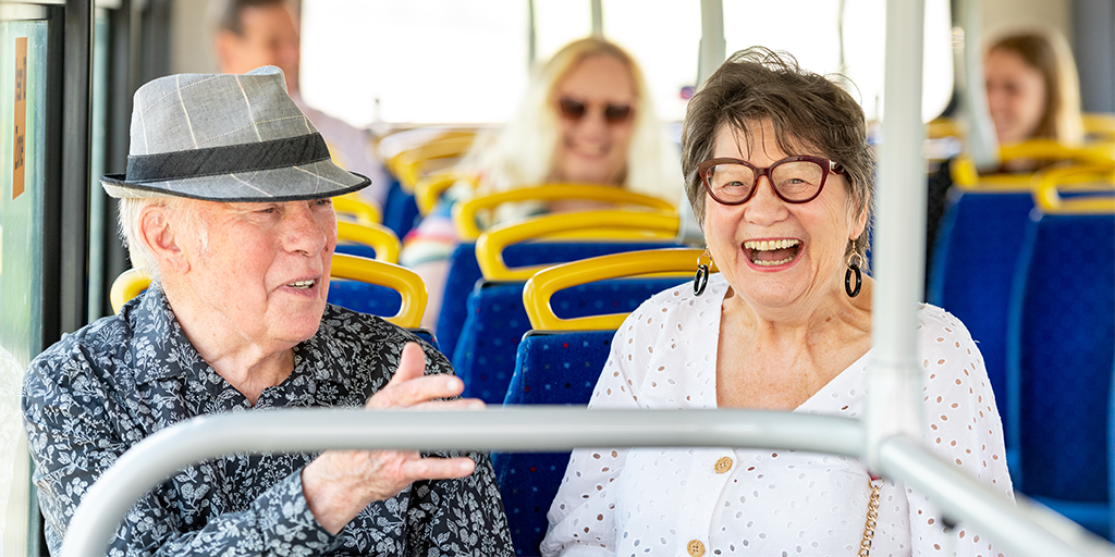 Image of a older couple enjoying their bus journey