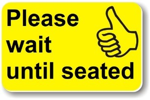 Illustration of a Helping Hand card reading 'Please wait until seated'
