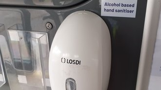 Photo of hand sanitiser pumps on a bus