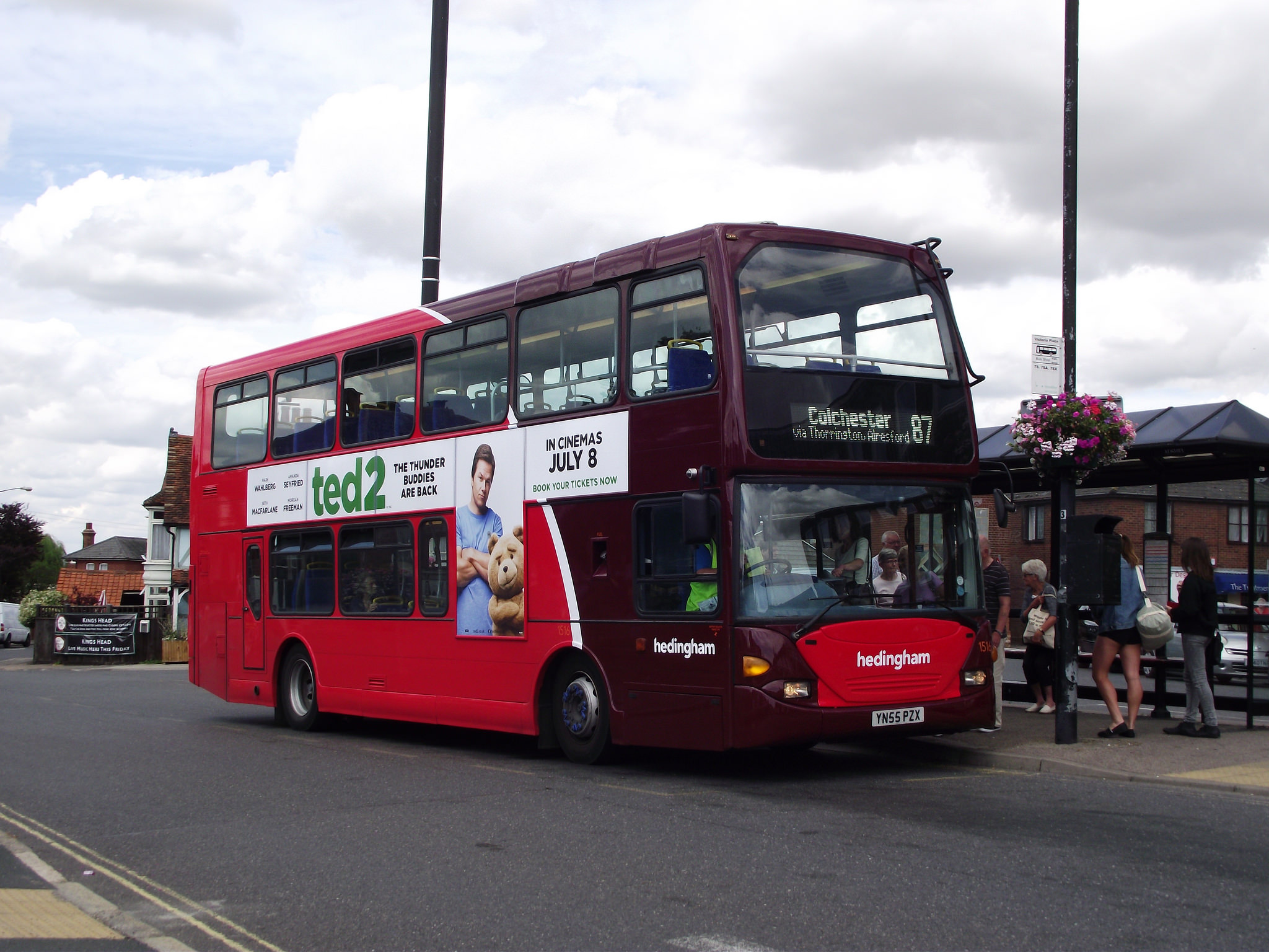 Photo of a Hedingham bus with advertising